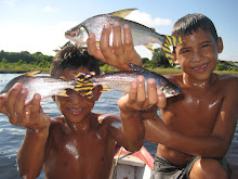 Locals showing us fish that their families caught.