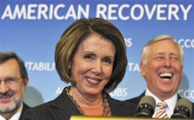 Nancy Pelosi grins.