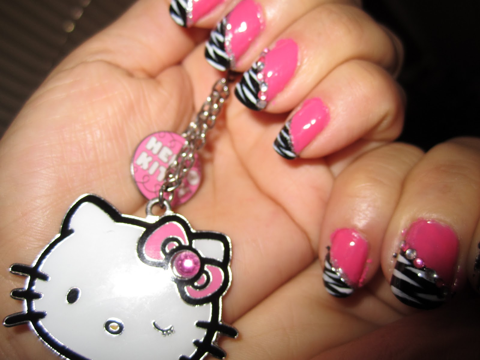 Pink and Black Zebra nail design / Blue rhinestones nail design title=