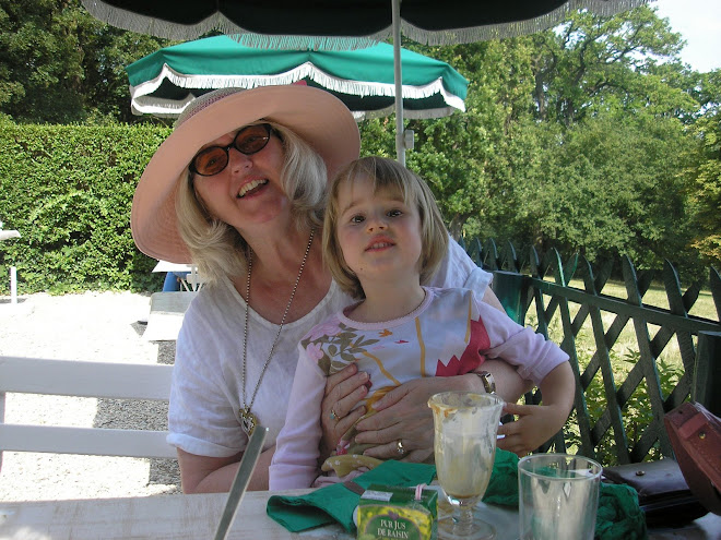 Wearing a hat in Paris with my granddaughter, Anaëlle