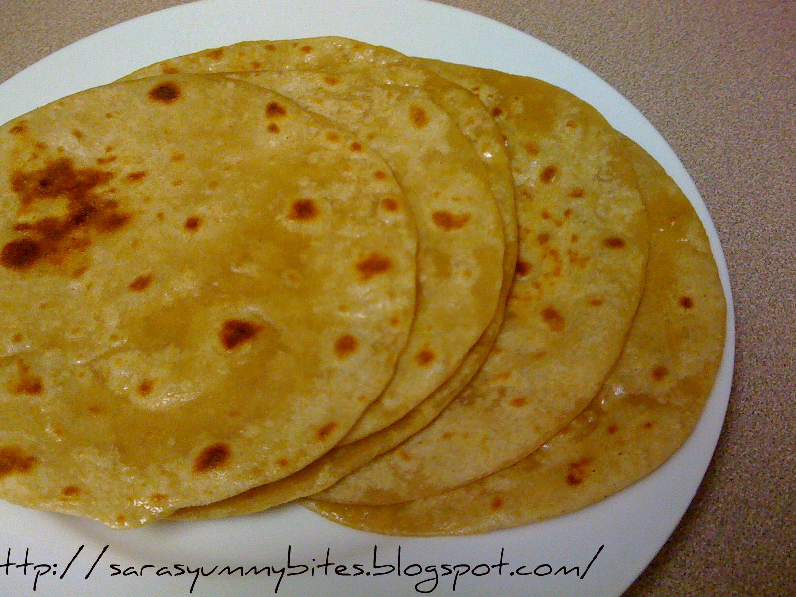 Chapatis or Roti is a flat unleavened bread which are made from a firm ...