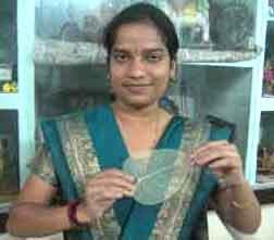 Madhangi Mohan holding banyan leaf skeleton