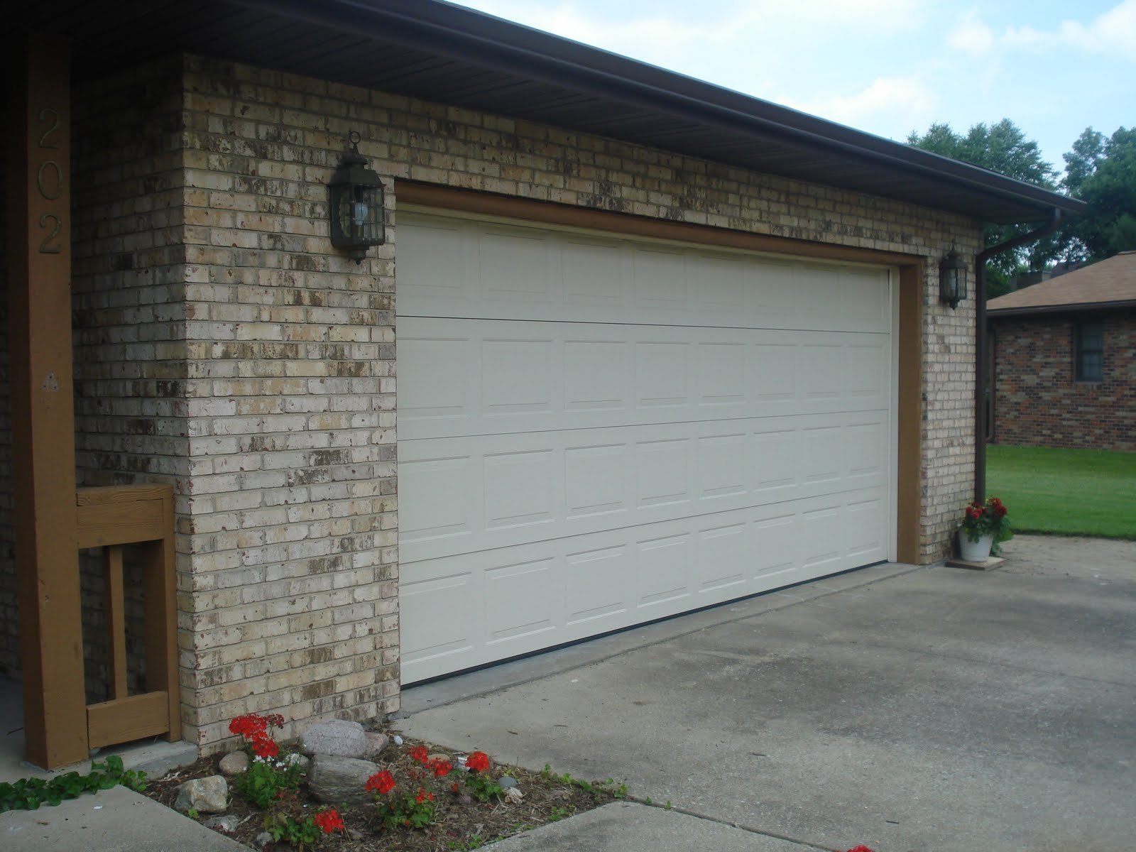 1200 #1590B6 Two Car Garage With New Garage Door Opener And Newer Garage Door Pull  image Walton Garage Doors 38131600