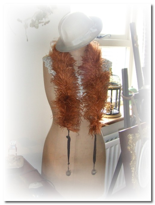 mannequin with feather boa and hat