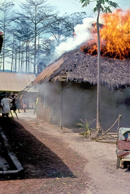thatch roof fire in village on road to Panguma