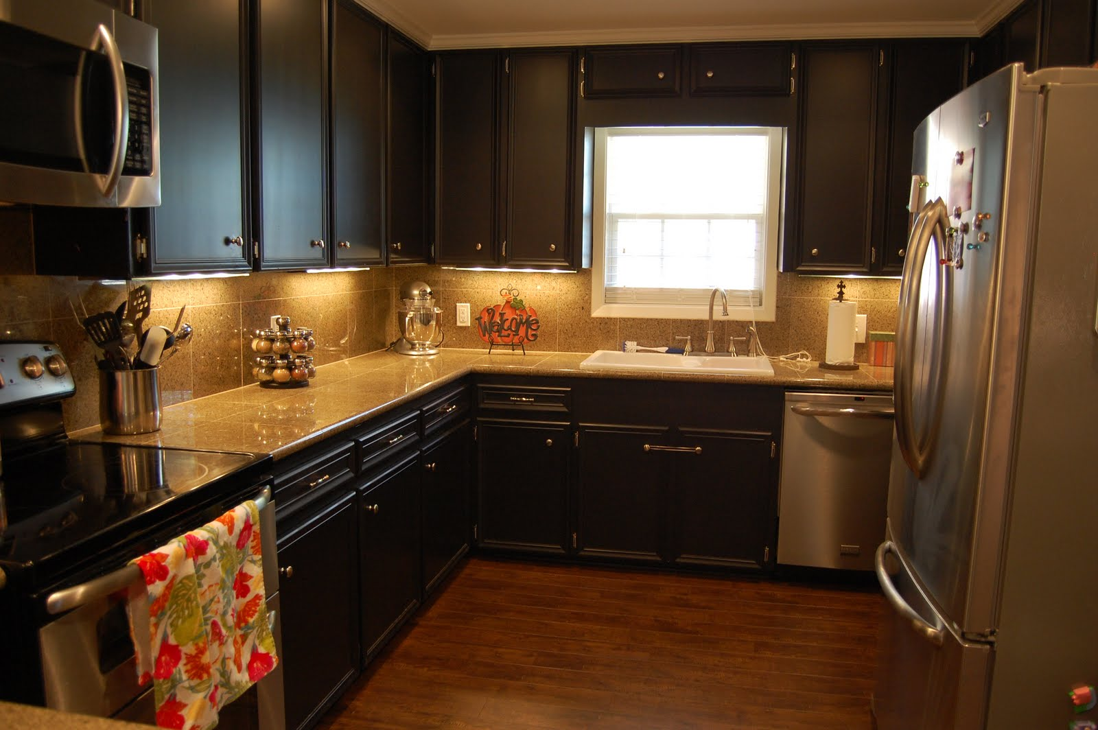 These are the same cabinets! We painted them SW Black Magic and added