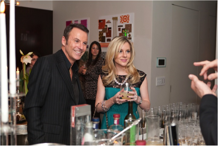 colin cowie and jacqueline weppner of merci new york at his new york city holiday party