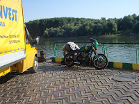 Elvis Cafe Racer on Ferry Over Danube River in Romania