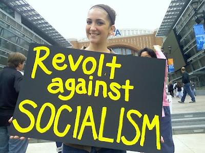 Dumbass! So-called socialism IS the revolution, the revolution against the wealthiest anti-taxers who would starve this nation even as they drain its lifeblood for their own profit.  You know what's really sad - this dimwit's from Dallas, where the parasitic aspect of the Rich is more than obvious.