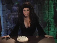 black dress, big boobs and dark hair - must be a horror hostess