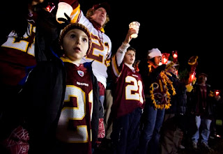 5-year-old Andrew Duncan attends a candlelight vigil for Sean Taylor