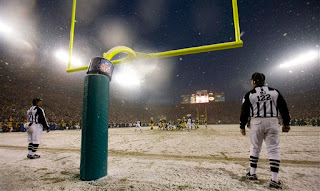 the referees watch a field goal through the snow
