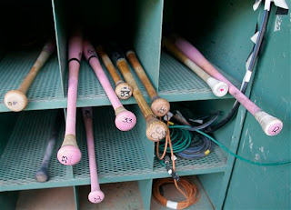 pink bats in the bat rack