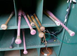 pink bats in the bat rack