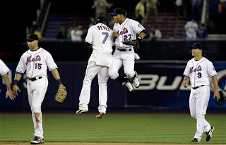 Jose Reyes and Carlos Gomez celebrate a Mets victory
