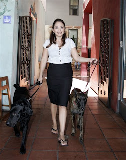 Marlena Cervantes the founder of FlexPetz with Jackpot (left) and Loki (right)