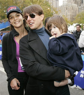 Katie Holmes meets Tom Cruise and Suri at the finish line