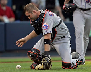 Brian Schneider's error helped the Braves get their first run.