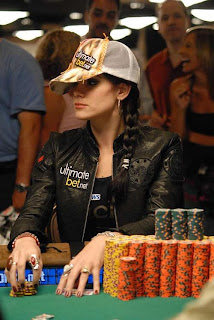 Hot Chips on Day 5 wearing both logos, the PokerNews logo is under her jacket