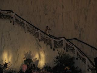 The bride descends the staircase