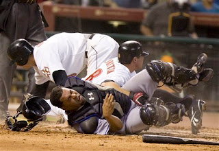 Ramon Castro gets plowed over by 2 runners at once