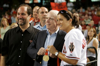 Misty May shows off her gold medal to John McCain