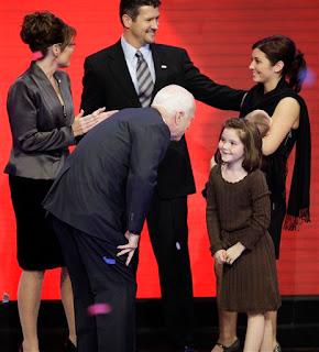 Piper Palin shares a laugh with John McCain
