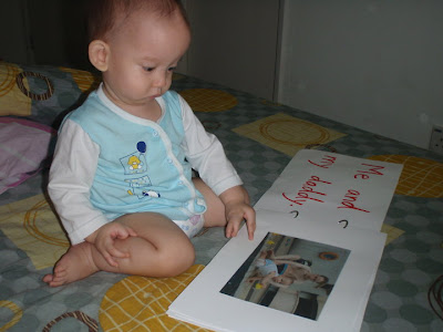 Baby Tim watch in his flipbook made by mommy