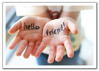 two hands with Hello Friend written in black in on inside of hands