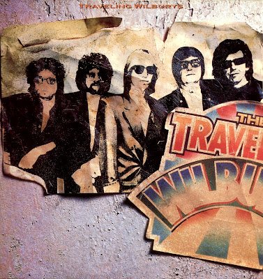 A rodar XV            - Página 4 The+Traveling+Wilburys+-+Vol.01+-+Front