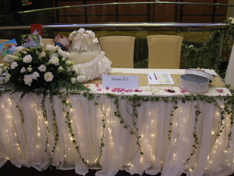 A centerpiece in the reception table with the bride and groom wedding photos