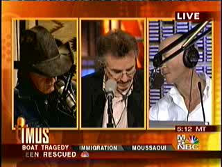Those of us who've watched Imus In the Morning are familiar with this infamous three-man camera shot.  It's (left to right) Don Imus, his news anchor Charles McCord, and producer Bernard McGuirk, probably verbally abusing someone important.