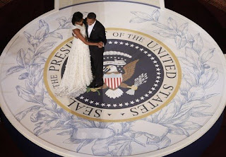 The Obamas enjoy their first official dance at the Neighborhood Ball, while Beyonce sang At Last from the movie Cadillac Records, a song made popular by Etta James. Mr. President wore Versace, the First Lady wore a white Narcisco Rodriguez ball gown