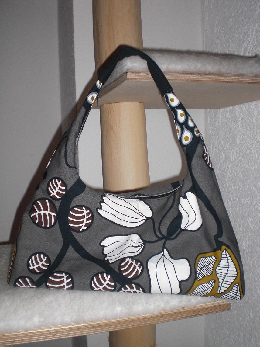 K*A*D*I*R*I*: Reisetasche mit passender Handtasche
