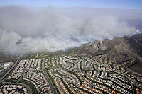 Wildfires advancing on suburban areas in California