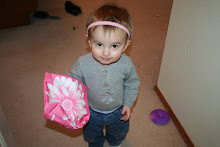 Uh oh! Pink headband and flower bag! And is that a necklace?