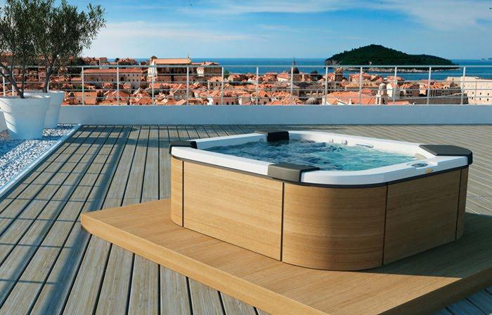 Casas minimalistas y modernas linea premium de jacuzzi for Casa moderna con jacuzzi