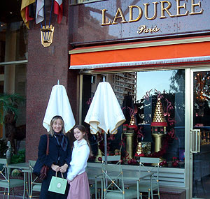outside Laduree clutching bag of macaroons