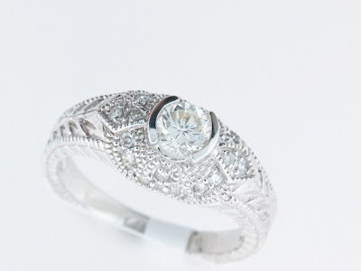 This dainty antique style ring has a 038 Carat round brilliant diamond