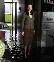 Jennifer Connelly, looking traumatized, standing ankle-deep in a flooded apartment.  That's pretty much all you need to know about the film.