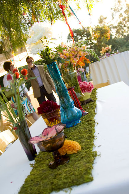 The mismatched vases and flowers were gorgeous at the wedding!
