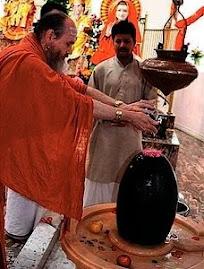 Hindus anointing phallus of Shiva
