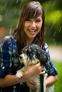 Girl in the rain with her pet dog