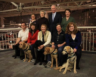 Captain Sullenberger with a group of Seattle puppy raisers