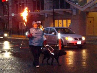 Heather and Nimitz in the torch relay