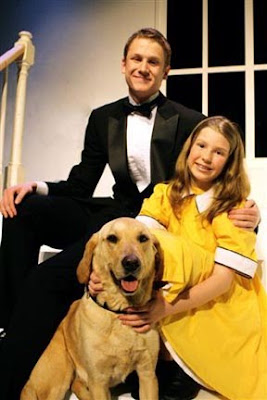 Career change yellow Lab Chanel in the Lincoln High School production of Annie.