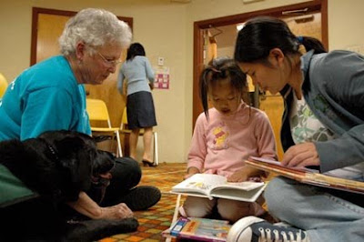 Filene, participating in a Read to the Dogs program
