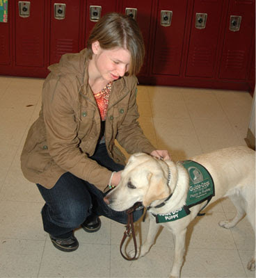 Puppy raiser Miranda Robertson, with puppy Candace