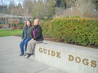 Michele Pouliot and Karen Pryor beside GDB sign on Oregon campus