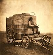 . en otra caja de madera más grande, varios cajones de productos químicos, . fenton's van